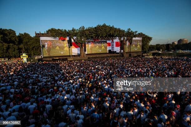 England football fans watch the Hyde Park screening of the FIFA 2018 World Cup semifinal match between Croatia and England on July 11 2018 in London...