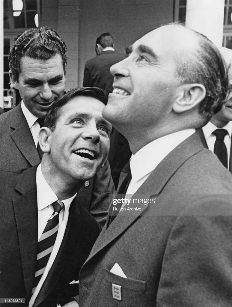 England football manager Alf Ramsey (1920 - 1999, right) meets comedian Norman Wisdom (1915 - 2010) during a visit to Pinewood Studios, Buckinghamshire, 12th July 1966.