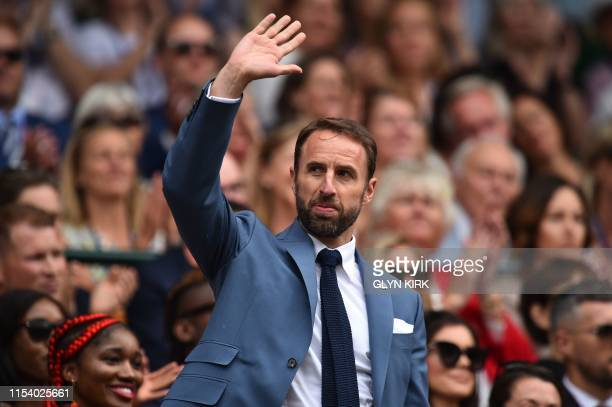 England football manager Gareth Southgate waves as he is presented in the Royal Box on Centre Court at The All England Tennis Club in Wimbledon...