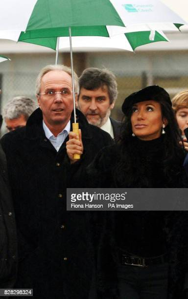England football manager Sven Goran Eriksson and his partner Nancy Dell'Olio shelter from the rain in south east London Wednesday January 18 during...