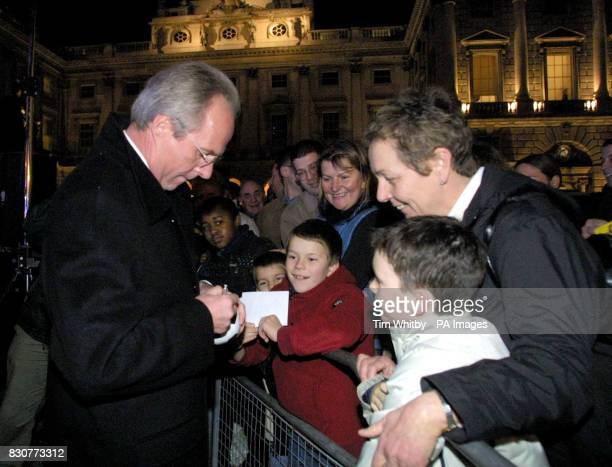 England football manager Sven Goran Eriksson sign autographs before pressing the switch to light the Christmas Tree at Somerset House in London also...