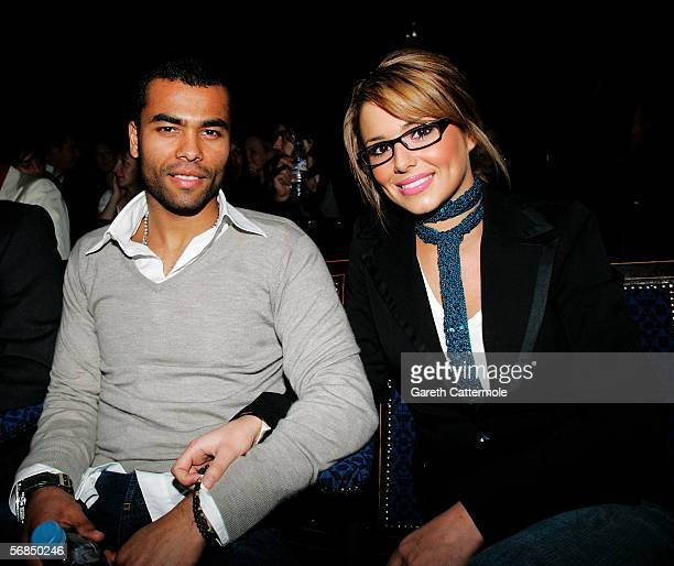 England football player Ashley Cole and singer Cheryl Tweedy of Girls Aloud attend the Julien Macdonald fashion show as part of London Fashion Week...
