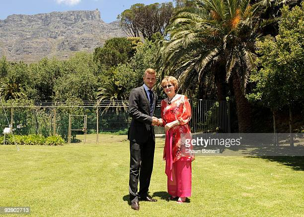 England football player David Beckham attends the media expo for countries bidding to host the FIFA World Cup 2018 December 4, 2009 with Helen Zille,...