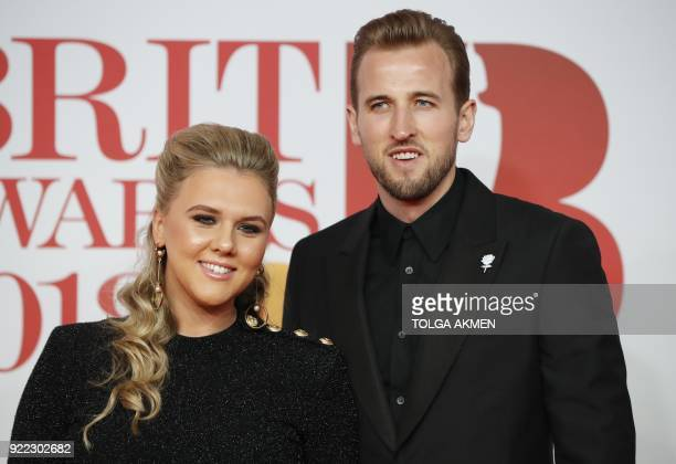 England football player Harry Kane and his partner Katie Goodland pose on the red carpet on arrival for the BRIT Awards 2018 in London on February 21...