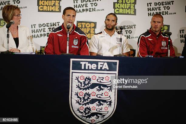 England football player Rio Ferdinand addresses the media whilst Home Secretary Jacqui Smith David James and David Beckham look on during a reducing...