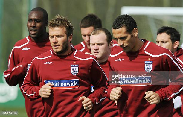 England football players Carlton Cole , David Beckham , Wayne Rooney and Rio Ferdinand warm-up during the team training session at Arsenal's training...