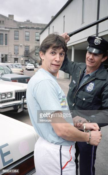England football star Gary Lineker is handcuffed by a police officer during a visit to a police station in Colorado Springs USA ahead of the 1986...