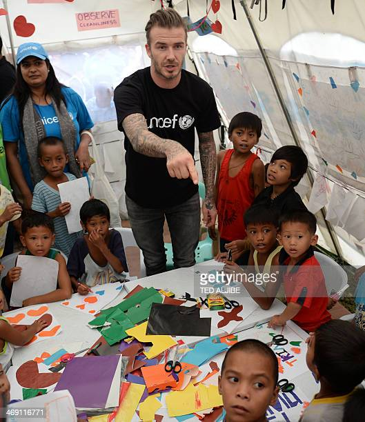 England football superstar David Beckham meets with young survivors of devastating Typhoon Haiyan during a visit to a tent city in Tacloban city,...