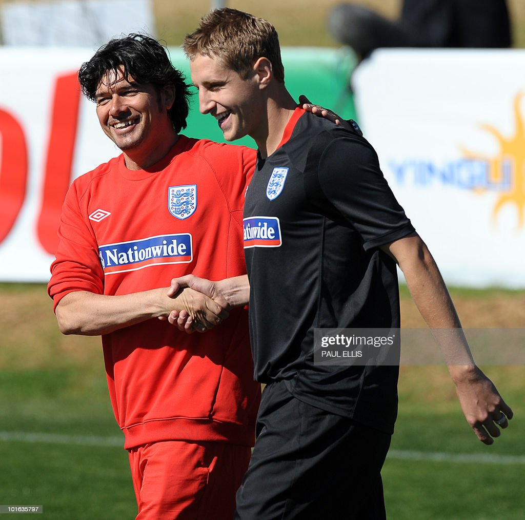 England football team coach Stefano Tirelli (L) welcomes replacement defender Michael Dawson as he arrives for a training session at the Royal Bafokeng Sports Campus near Rustenburg on June 5, 2010. Dawson was flown from England to replace captain Rio Ferdinand after he injured his knee during the team's first training session in the country prior to the World Cup 2010 kick-off in South Africa.