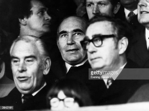 England football team manager Sir Alf Ramsey watching a match between Millwall and Norwich City He was manager of the English national team from 1963...