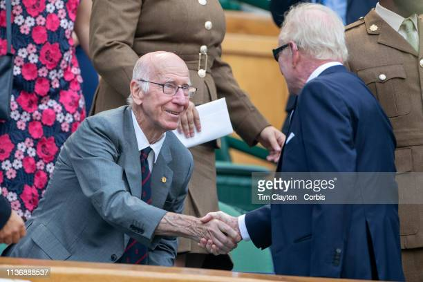 England footballer Bobby Charlton and Australian tennis player Rod Laver greet each other on Centre Court during the Wimbledon Lawn Tennis...