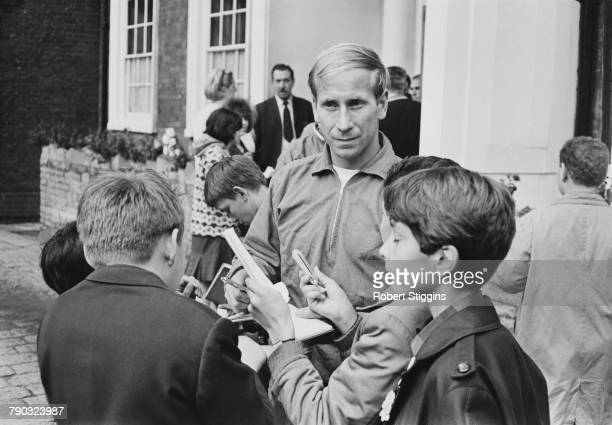 England footballer Bobby Charlton signs autographs for fans outside the Hendon Hall Hotel, Hendon, London, during the 1966 World Cup tournament, 27th...