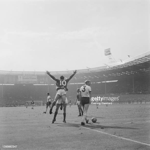 England footballer Geoff Hurst being hugged by a team-mate at Wembley Stadium in London, during the World Cup Final between England and West Germany,...