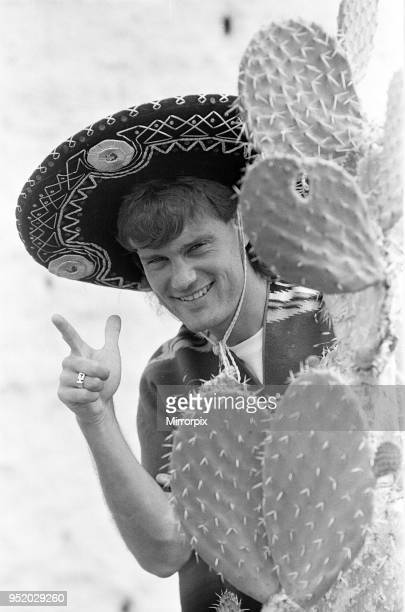 England footballer Glenn Hoddle poses as a Mexican bandit standing behind a cactus at the team base in Monterrey Mexico prior to the 1986 World Cup...