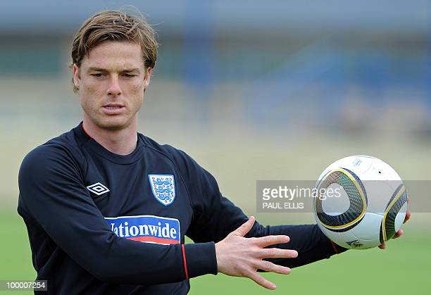 England footballer Scott Parker stretches during a team training session in Irdning Austria on May 19 2010 ahead of the World Cup Finals in South...