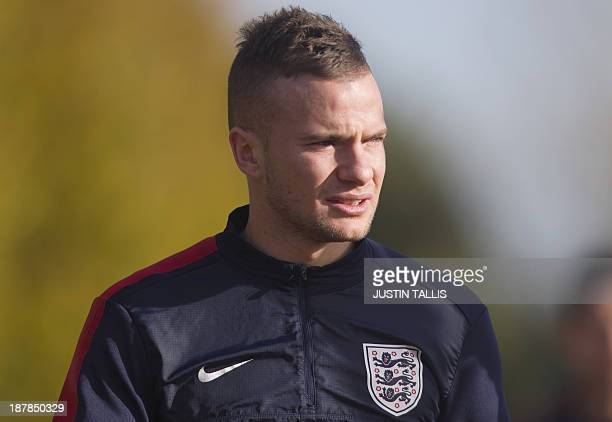 England footballer Tom Cleverley arrives for a training session at Arsenal's training ground, London Colney, north of London on November 13, 2013...