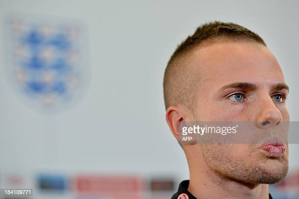 England footballer Tom Cleverley listens to questions during a press conference at The Grove hotel north of London on October 14 2012 England are set...