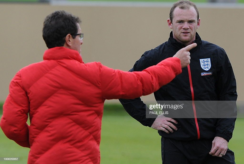 England footballer Wayne Rooney (R) listens to Fabio Capello during a training session in Irdning, Austria on May 19, 2010 ahead of the World Cup Finals in South Africa.