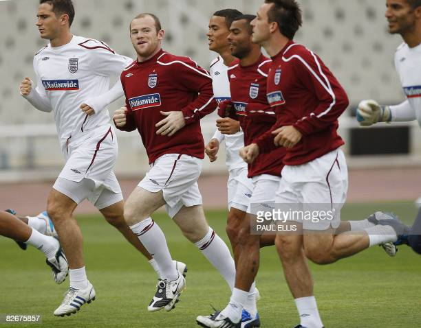 England footballer Wayne Rooney runs with teammates during a training session at The Olympic Stadium in Barcelona on September 5 2008England take on...