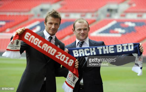 England footballers David Beckham and Wayne Rooney pose during a photocall to launch The England 2018 / 2022 World Cup bid at Wembley Stadium in...
