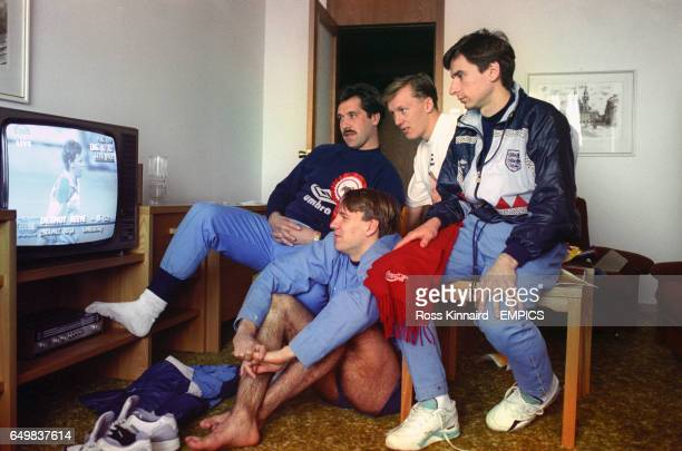 England footballers David Seaman Paul Merson Lee Dixon and Alan Smith watch the Cricket World Cup final between England and Pakistan on a television
