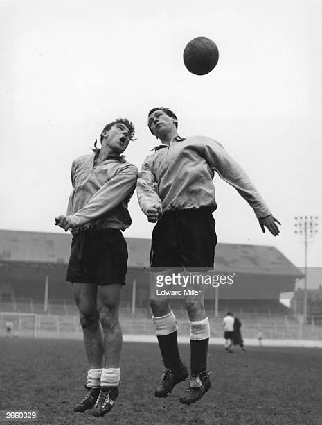 England footballers Duncan Edwards and Bobby Robson get some heading practice before their match against France.