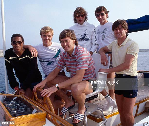 England footballers : John Barnes, Kerry Dixon, Bryan Robson, Glenn Hoddle, Dave Watson and Terry Fenwick on board a power boat during the team's...