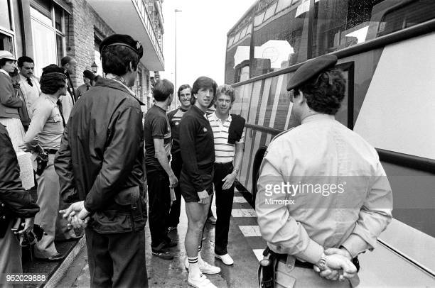 England footballers Paul Mariner and Graham Rix wait to board the bus at the team hotel during the 1982 World Cup Finals in Spain June 1982