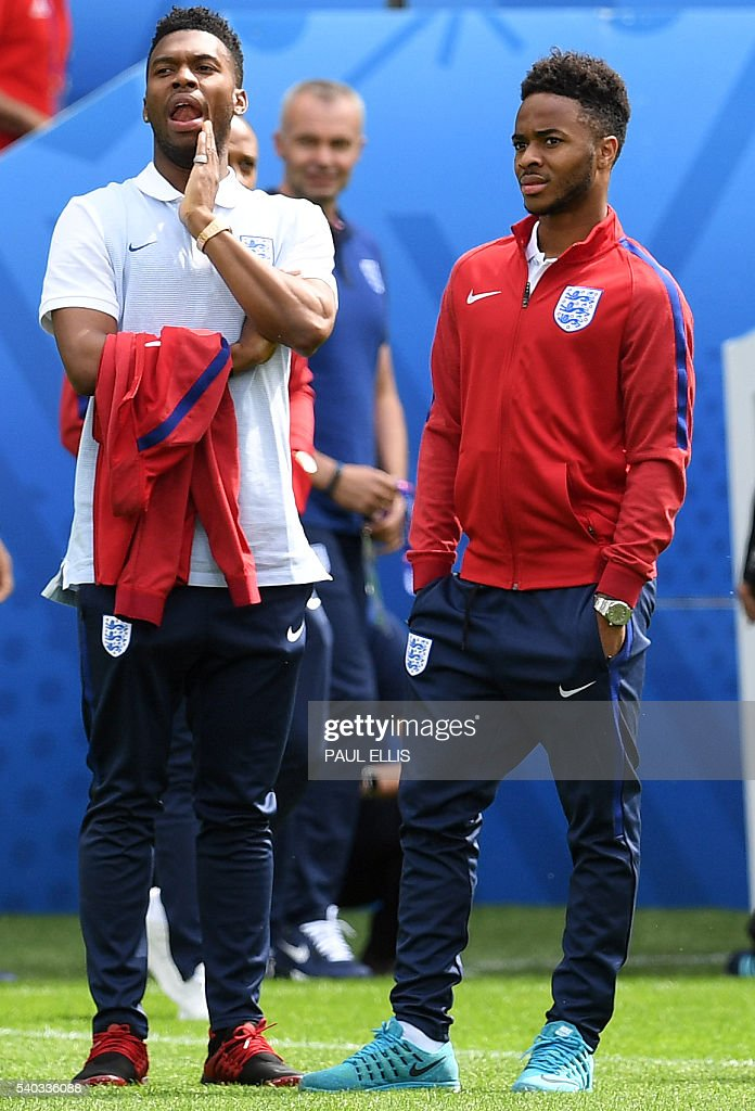 England forward Daniel Sturridge (L) and England midfielder Raheem Sterling stand on the pitch in Lens, France on June 15, 2016 during a pitch walkabout of the Euro 2016 football tournament. England prepares to face Wales on June 16, 2016. / AFP / PAUL