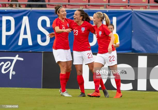 England forward Lucy Stanforth scores Englands first goal of the game and celebrates with England forward Beth Mead and England forward Jodie Taylor...