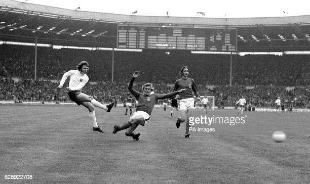 England forward Mike Channon scores the second goal in the 31st minute past Wales' John Roberts and Rod Thomas in the England v Wales international...