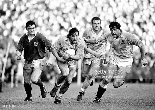 England forward Mike Teague carries the ball with Dean Richards and Wade Dooley in support during the Five Nations Championship rugby union match...