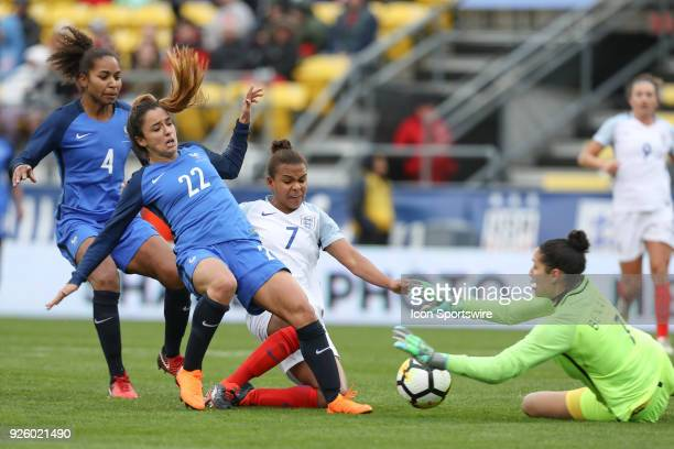 England forward Nikita Parris attempts a shot on goal as France defender Sakina Karchaoui defends and France defender Amel Majri blocks during the...
