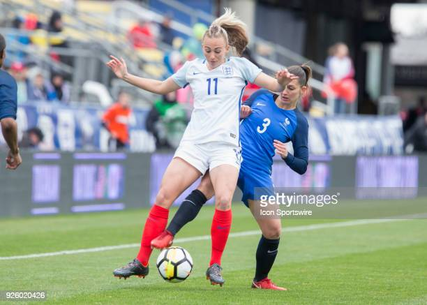 England forward Toni Duggan and France defender Eve Perisset battle for the ball during the first half of the match between England and France in the...