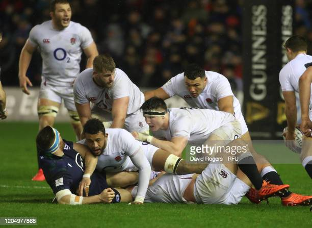 England forwards Tom Curry Ellis Genge George Kruis and Courtney Lawes win the ball during the 2020 Guinness Six Nations match between Scotland and...