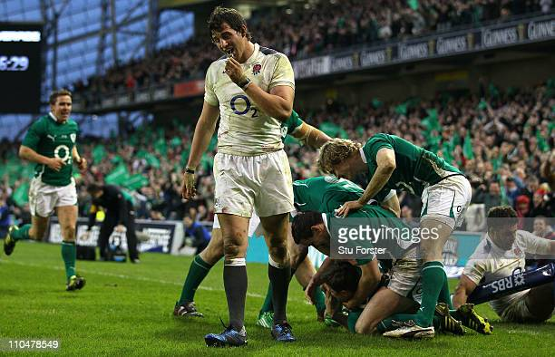 England forwards Tom Wood and Nick Easter look on dejectedly as Ireland centre Brian O'Driscoll and team mates celebrate his try during the RBS 6...