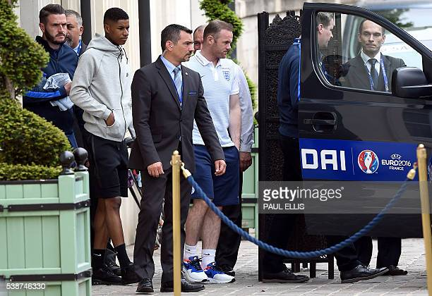 England forwards Wayne Rooney and Marcus Rashford leave the team hotel in Chantilly on June 8 two days prior to the beginning of the Euro 2016...