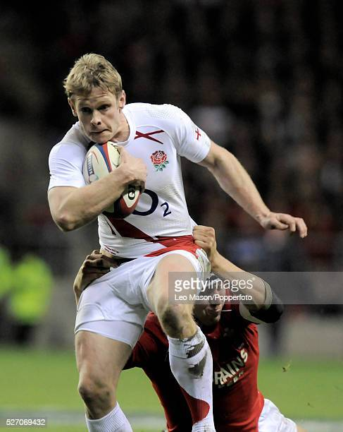 England full back Iain Balshaw tries to break a tackle by Wales' full back Lee Byrne
