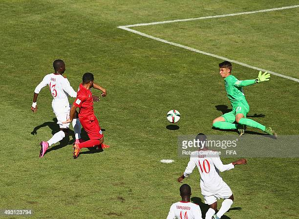 England goalkeeper Alfie Whiteman makes a save to deny Ives Camara of Guinea a goal during the FIFA U17 World Cup Group B match between England and...