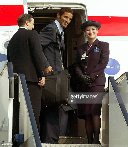 England goalkeeper David James chats to stewardess Jacqueline Norris as he boards the British Airways flight at Manchester Airport which will carry...