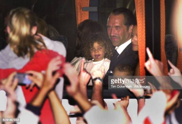 England goalkeeper David Seaman holding his daughter Georgina on a coach at Heathrow Airport London The England team have arrived back from Japan...