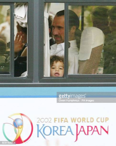 England goalkeeper David Seaman leaves Awaji Island by coach with his daughter Georgina after England's 21 defeat by Brazil in the World Cup...