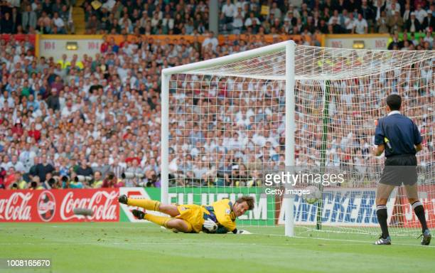 England goalkeeper David Seaman makes a penalty save during the peanlty shoot out after a 00 draw with Spain in the quarter finals of the 1996 UEFA...