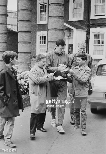 England goalkeeper Gordon Banks signs autographs for fans outside the Hendon Hall Hotel Hendon London during the 1966 World Cup tournament 27th July...