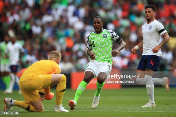 England goalkeeper Jordan Pickford collects the ball at the feet of Odion Ighalo of Nigeria during an International Friendly between England and...