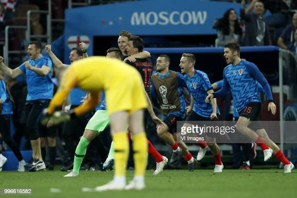 England goalkeeper Jordan Pickford Luka Modric of Croatia Mario Mandzukic of Croatia Mateo Kovacic of Croatia Filip Bradaric of Croatia Duje...