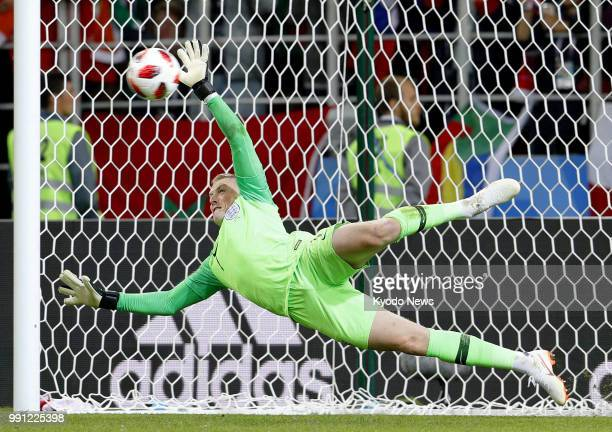 England goalkeeper Jordan Pickford saves a penalty kick from Colombia's Carlos Bacca after their World Cup roundof16 match ended 11 after extra time...