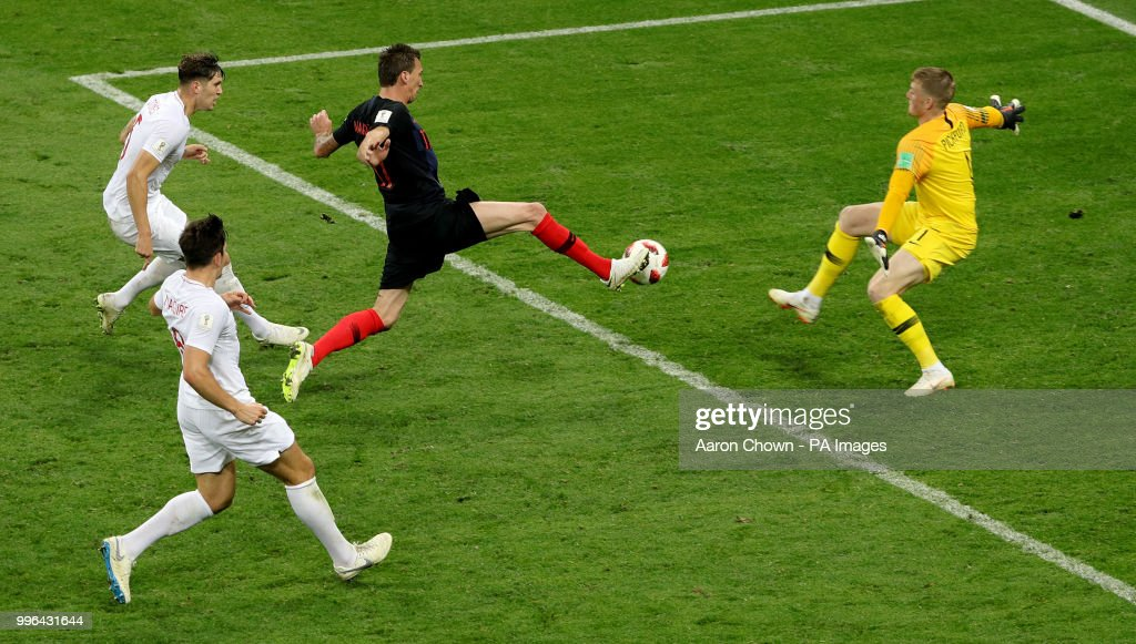 England goalkeeper Jordan Pickford (right) saves from a shot by Croatia's Mario Mandzukic (left) during the FIFA World Cup, Semi Final match at the Luzhniki Stadium, Moscow.