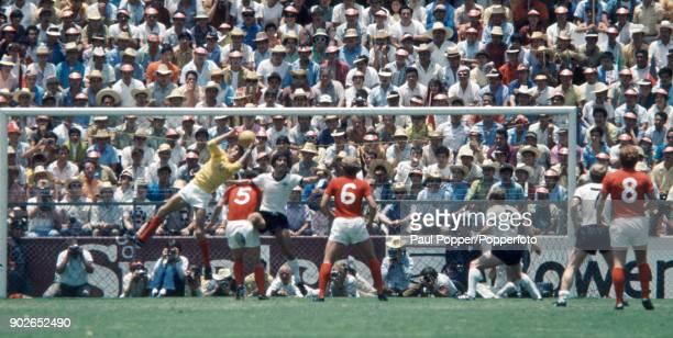 England goalkeeper Peter Bonetti catches the ball under pressure from German striker Gerd Muller during the FIFA World Cup quarter final match...