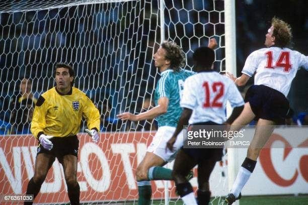 England goalkeeper Peter Shilton watches as Mark Wright heads the ball clear from West Germany's Guido Buchwald